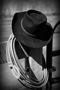Branding Framed Prints - Cowboy Hat on Fence Post in Black and White Framed Print by Paul Ward