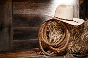 Rope Framed Prints - Cowboy Hat on Hay Bale Framed Print by Olivier Le Queinec