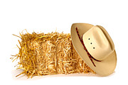 Ranch Framed Prints - Cowboy Hat on Straw Bale Framed Print by Olivier Le Queinec