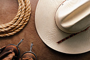 Roping Framed Prints - Cowboy Hat with Spurs and Rope Framed Print by Olivier Le Queinec