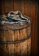 Leather Gloves Prints - Cowboy Spurs on Wooden Barrel Print by Paul Ward