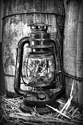 Roper Photos - Cowboy themed Wood Barrels and Lantern in black and white by Paul Ward