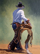 Western Shirt Posters - Cowboy With Saddle Poster by Randy Follis