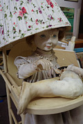 Hand Prints - Creepy old doll with broken leg in a high chair with a lampshade Print by Amy Cicconi