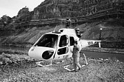 Instruction Framed Prints - Crew Member Calling Passengers Forward For Boarding Papillon Helicopter Tours Landed On Pad Down In  Framed Print by Joe Fox