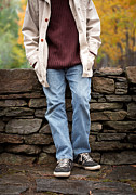 Man Photos - Cropped man standing against a stone wall by Edward Fielding