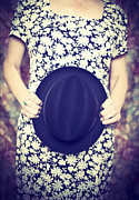 Woman Prints - Cropped woman holding a vintage hat Print by Edward Fielding