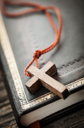 Gold Necklace Photo Posters - Cross on Bible Poster by Elena Elisseeva