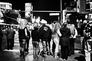 Crosswalk Photos - crowd of people standing waiting for crosswalk lights to change Las Vegas Nevada USA by Joe Fox
