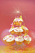Candle Lit Prints - Cupcakes with sparkler on top  Print by Sandra Cunningham