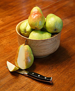 Food And Beverage Photo Originals - Cut Pear with Pears in Wood Bowl by Darryl Brooks