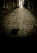 Paved Street Prints - Dark alley in old historic city Print by Edward Fielding