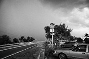 Mile Road Posters - Dark Rain Storm Clouds Blow Over The Seven Mile Bridge Marathon Key Car Park Florida Keys Usa Poster by Joe Fox