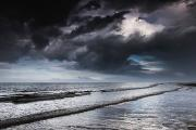 Dark Skies Posters - Dark Storm Clouds Over The Ocean With Poster by John Short