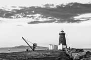 Black Clouds Prints - Davit and Lighthouse on a Breakwater Print by Semmick Photo