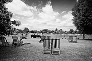Deckchair Framed Prints - deckchairs laid out in hyde park London England UK Framed Print by Joe Fox
