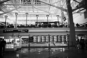 Airport Concourse Prints - departures board at concourse b Denver International Airport Colorado USA Print by Joe Fox