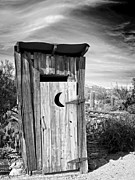 Ghost Town Outhouse Prints - Desert Outhouse Under Stormy Skies Print by Lee Craig