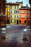 Colorful Houses Prints - Deserted street with colored houses in Parma Italy Print by Silvia Ganora