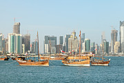 Wooden Ship Prints - Dhows and Doha skyline 2012 Print by Paul Cowan