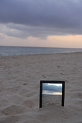 Digital Tablet In Sand On Beach At Sunrise Print by Sami Sarkis