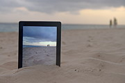 Out Of Context Posters - Digital tablet in sand on beach Poster by Sami Sarkis