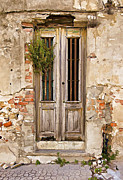 Medieval Entrance Photo Prints - Dilapidated Brown Wood Door of Portugal Print by David Letts