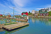 Boats At Dock Framed Prints - Dock at High Tide in Halls Harbour-NS Framed Print by Ruth Hager