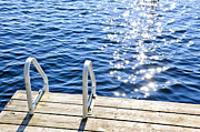Sunlight Metal Prints - Dock on summer lake with sparkling water Metal Print by Elena Elisseeva