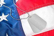 Identification Symbol Framed Prints - Dog tags on American flag Framed Print by Joe Belanger