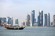 Moored Boat Framed Prints - Doha city skyline 2012 Framed Print by Paul Cowan