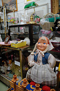 Signs Posters - Doll and other items in antique shop Poster by Amy Cicconi