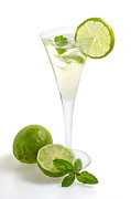 Ice Wine Prints - Drink with lime and mint in a champagne glass Print by Palatia Photo