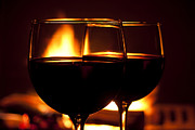 Wine-glass Photo Prints - Drinks by the Fire Print by Andrew Soundarajan