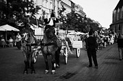 Polish City Framed Prints - Drivers And Tourist Horse Drawn Carriage In Rynek Glowny Old Town Square Stare Miasto Krakow Framed Print by Joe Fox