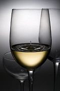 White Wine Photo Framed Prints - Drops Of Wine In Wine Glasses Framed Print by Setsiri Silapasuwanchai