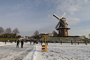 Outlook Posters - Dutch winter scene skaters and windmill at Dokkum Poster by Bart De Rijk