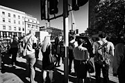 Crosswalk Framed Prints - early morning commuters waiting to cross the road pedestrian crossing London England UK Framed Print by Joe Fox