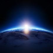 Earth Sunrise Over Cloudy Ocean  Print by Johan Swanepoel