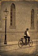 Tandem Bicycle Prints - Edwardian Man Riding A Tandem On A Cobbled Street Print by Lee Avison