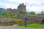 Skye Photos - Eilean Donan Castle and the Lone Piper by Chris Thaxter