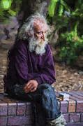 Sheila Smart - Elderly man sits on a...