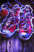 Electric Light Framed Prints - Electric tennis shoes  Framed Print by Garry Gay