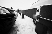 Sask Prints - Electrical Power Sockets In Outdoor Parking Lot For Engine Block Heaters Saskatchewan Canada Print by Joe Fox