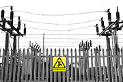 Electric Pylon Framed Prints - Electricity Sub Station Behind Barbed Wire Framed Print by Fizzy Image
