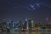 Thunderstorm Framed Prints - Electrifying New York City Framed Print by Susan Candelario
