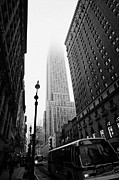 Manhatan Framed Prints - Empire State Building shrouded in mist and NYC bus taken from 34th and Broadway nyc new york city Framed Print by Joe Fox