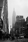 Manhaten Prints - Empire State Building Shrouded In Mist As Pedestrians Crossing Crosswalk On 7th Ave And 34th Street  Print by Joe Fox