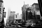Manhatan Photo Prints - empire state building shrouded in mist from west 34th Street and 7th Avenue King Kong movie poster Print by Joe Fox