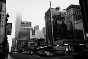Manhatten Framed Prints - empire state building shrouded in mist from west 34th Street and 7th Avenue new york city usa Framed Print by Joe Fox